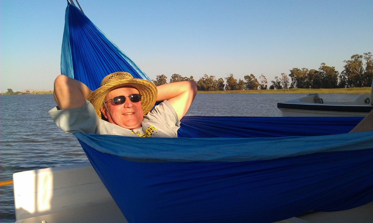 The author relaxes in a hammock slung under the boom.