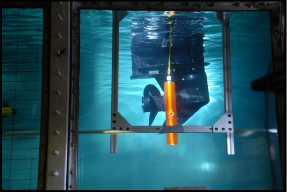 A look inside the testing tank with the simulated ballistics leg extended toward an exposed propeller.