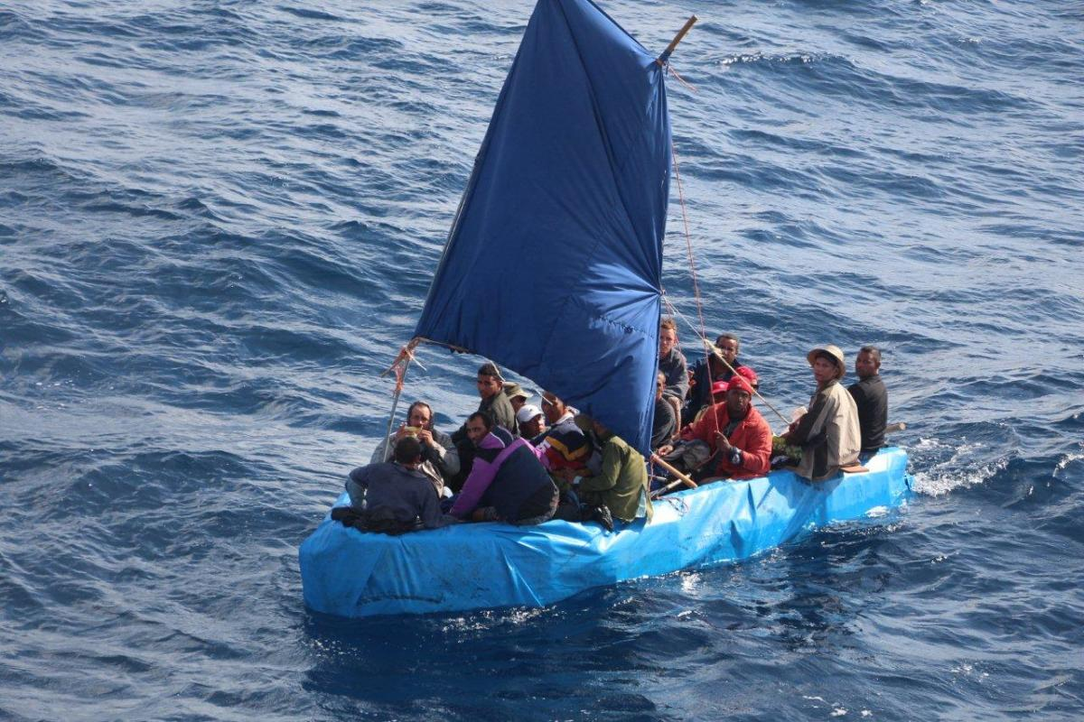 Cuban migrants sail a rustic vessel south of Key West, Florida, Jan. 1, 2015. The Coast Guard Cutter Mohawk interdicted the 24 Cuban migrants and were later repatriated to Bahia de Cabañas, Cuba. U.S. Coast Guard photo.