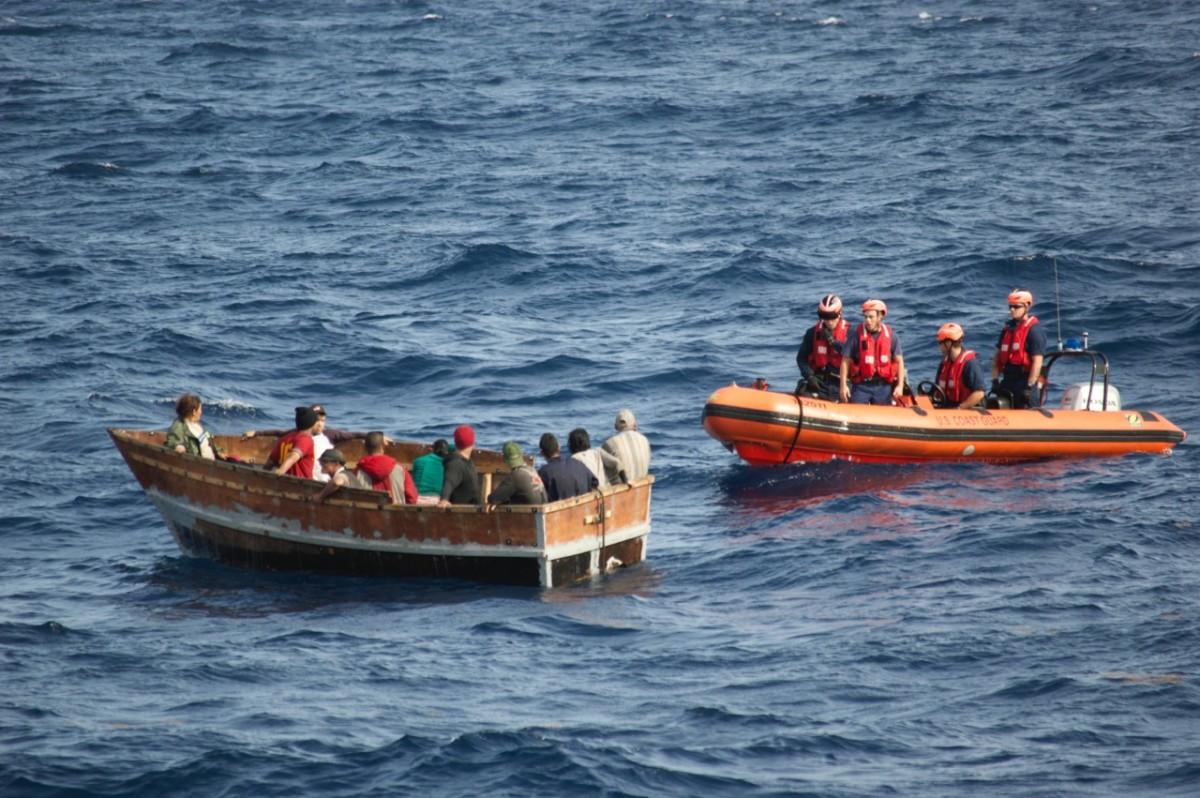 A boatcrew with the Coast Guard Cutter Knight Island approaches a rustic vessel southwest of Key West, Florida, Dec. 30., 2014. The rustic vessel had 12 Cuban migrants aboard who were later repatriated to Bahia de Cabañas, Cuba, Jan. 5, 2015. (U.S. Coast Guard photo.)
