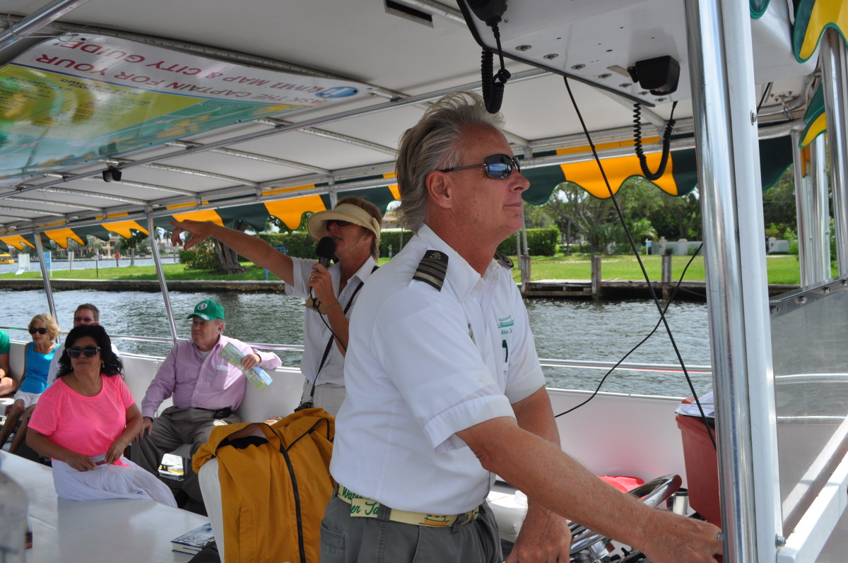 Water taxi skippers act as tour guides, pointing out the homes of the rich and famous.