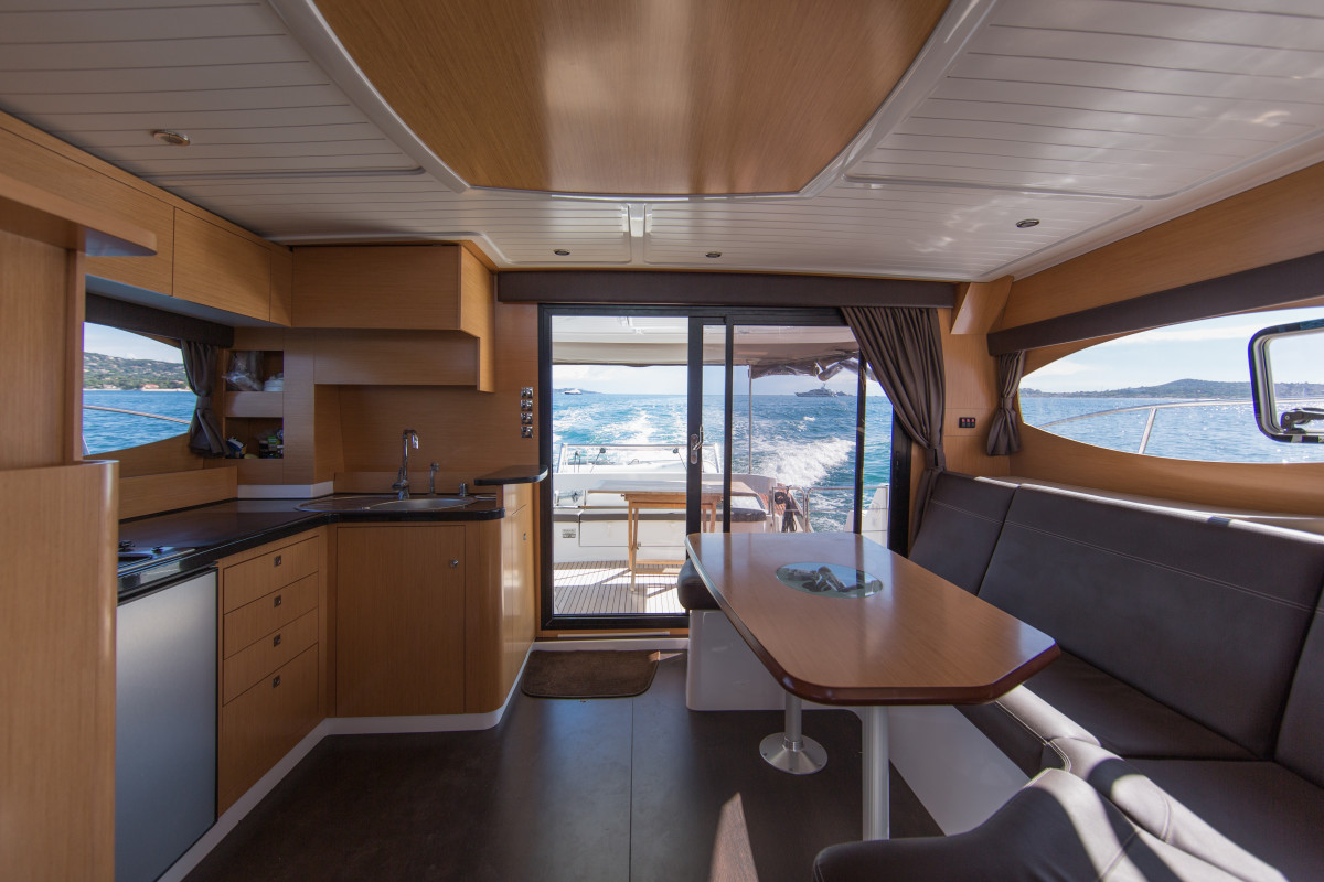 Behind the helm is a brightly lit and well finished galley and saloon, perfect for hosting.