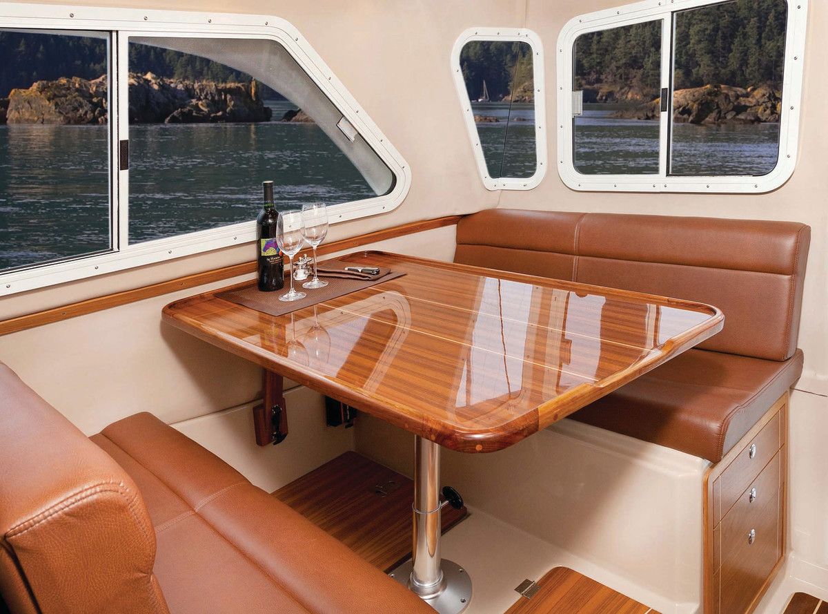 A large dinette occupies the space behind the helm.