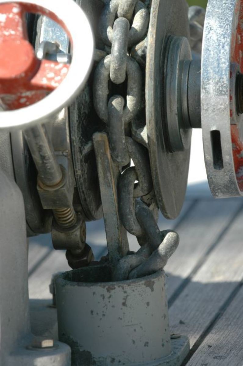 This chain is clearly jammed in the chain pipe, a result of an improperly aligned chain stripper.