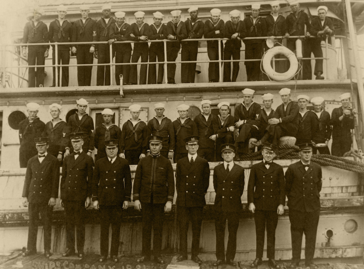 Ship's Company beside and on USS Conestoga, at San Diego, California, circa early 1921. (U.S. Naval History and Heritage Command NH 71503)