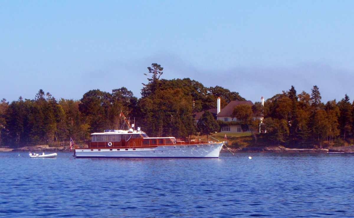 A fine old motoryacht is moored off Isleboro.