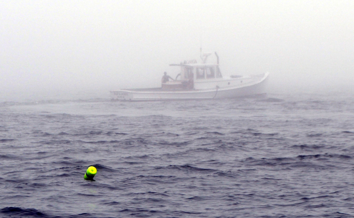 Nothing like a white hull to provide camo in fog.