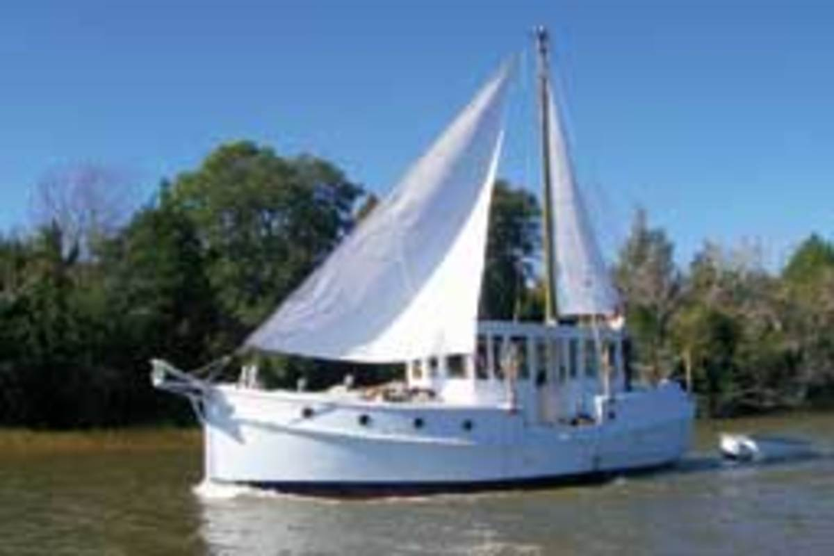"Rudy & Jill Sechez built their 34-foot wooden, ""sail assisted troller."""""