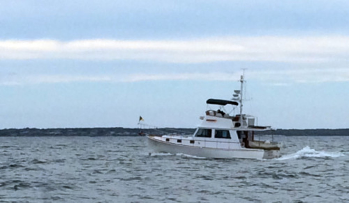 Passing by Ben Ellison's Duffy 37, Gizmo.