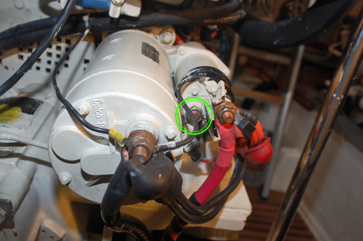 While cranking the engine, test for voltage as shown in the photo. The other meter lead should touch a good, clean ground elsewhere on the engine.