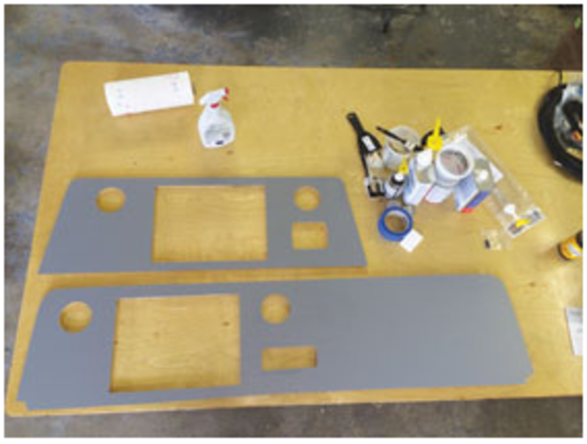 An installer fabricated new dashboards for the two helm stations.
