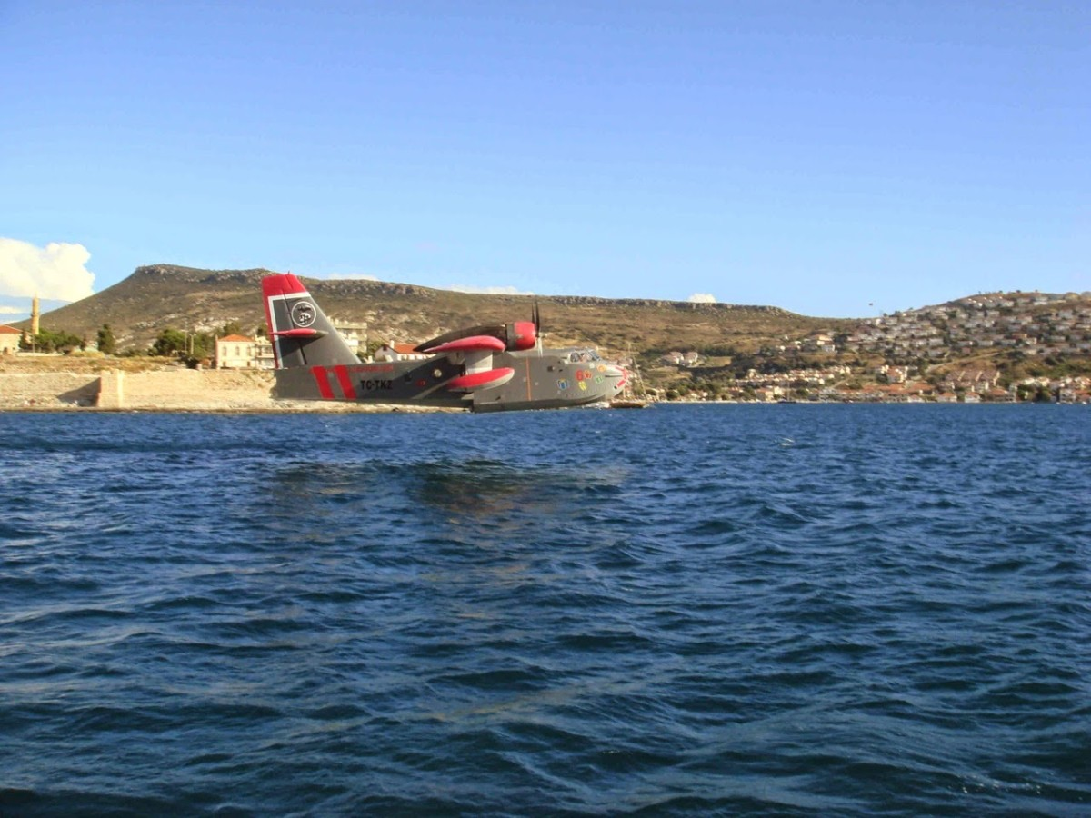 The fire fighting airplane scooping up water.