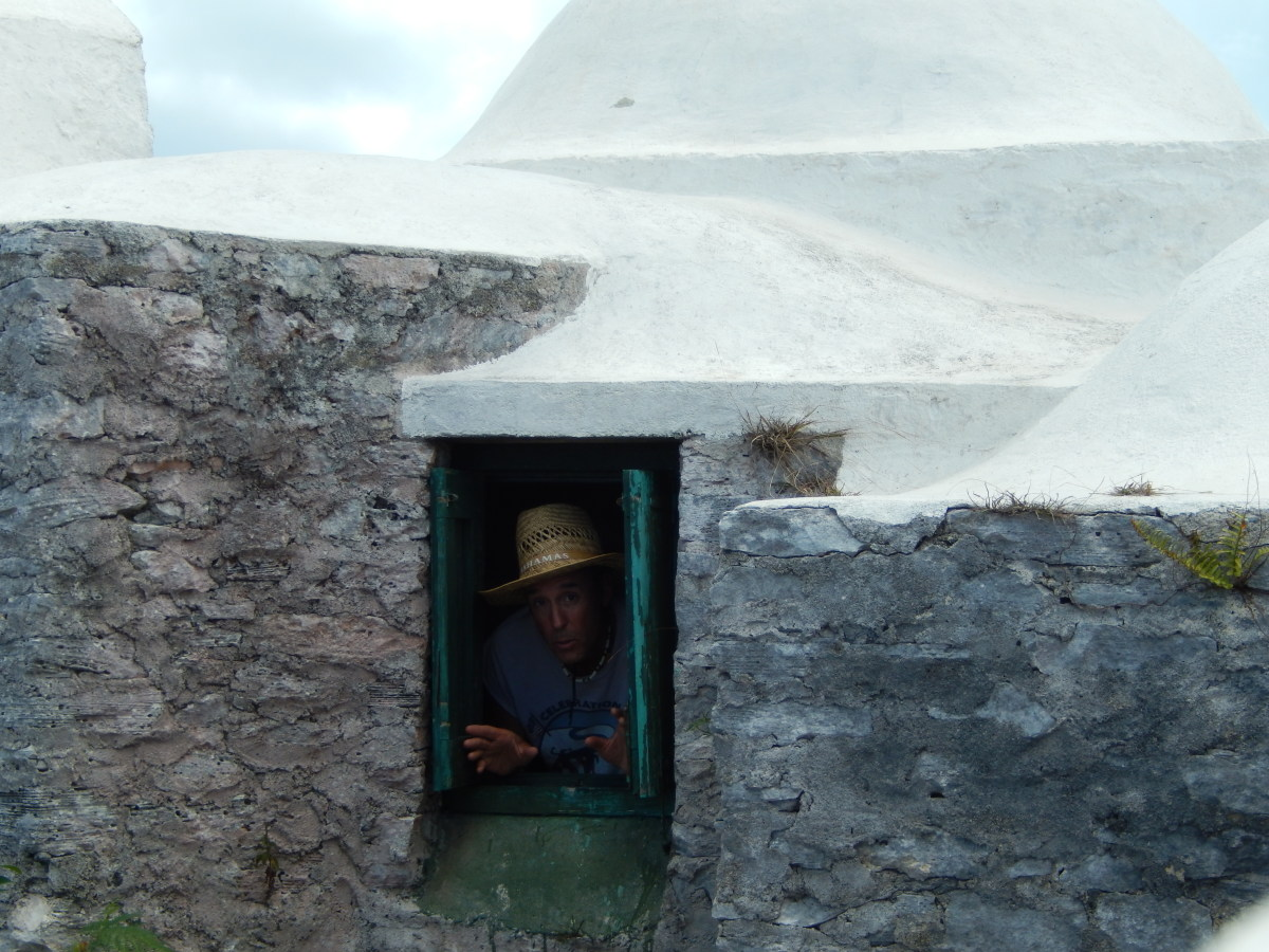The author pokes his head out of a hermitage window. The whole structure was a tight squeeze.