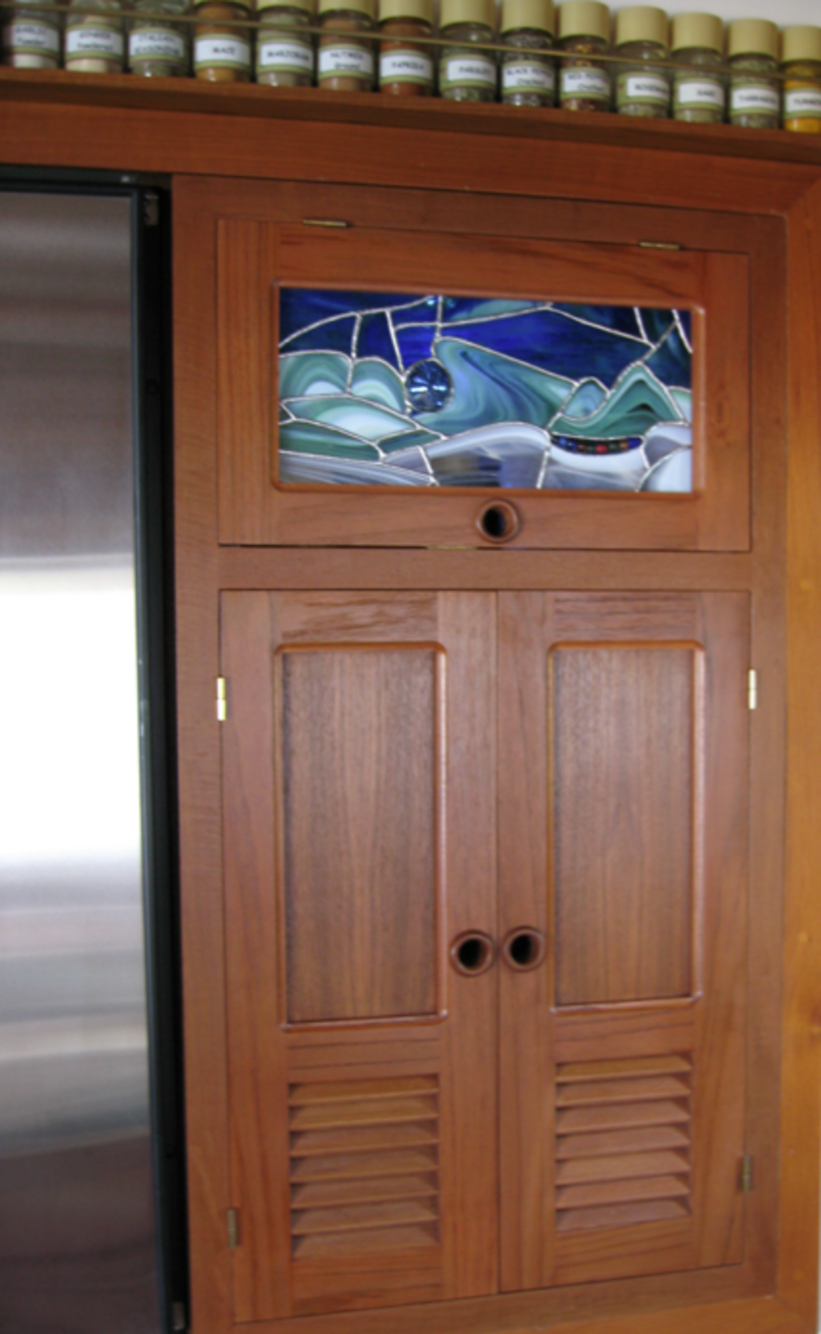 The couple added plenty of character to their cruiser with detail like this stained glass in the galley.
