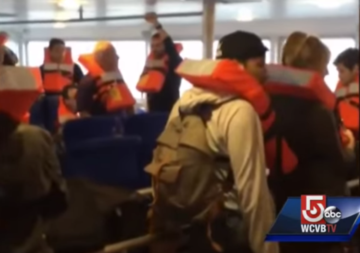 Cell phone video shows passengers gathered in life vests.