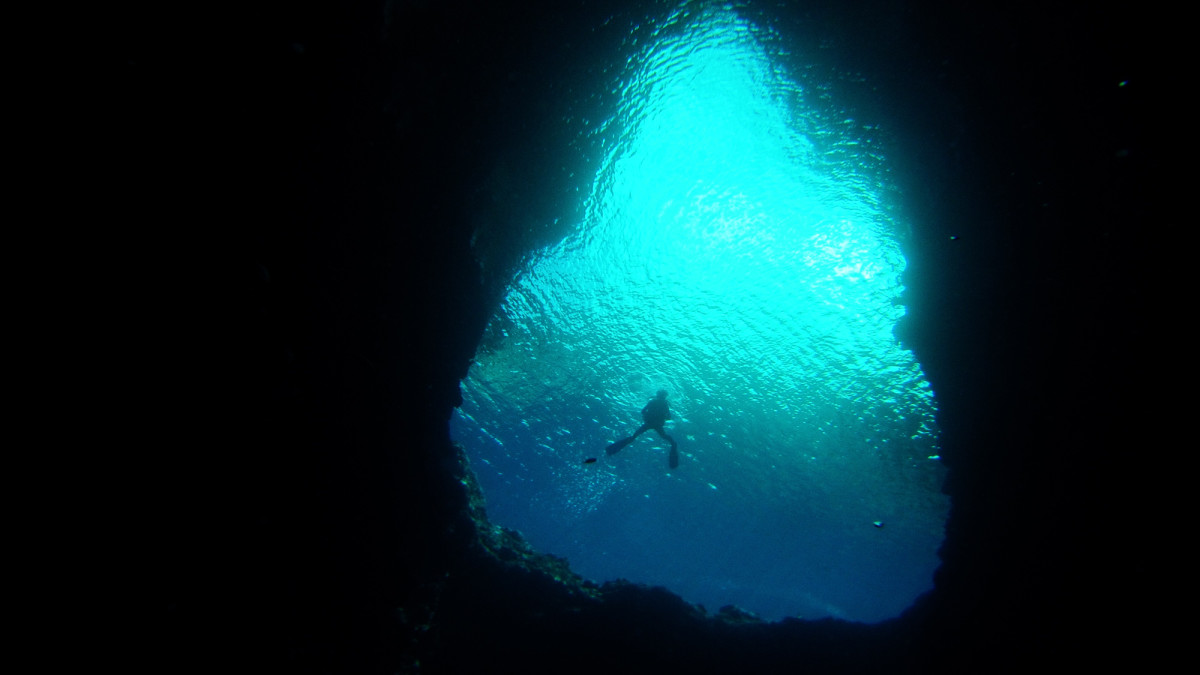Jennifer entering Swallow's Cave, one of several excellent dives in Tonga's Vava'u Group.