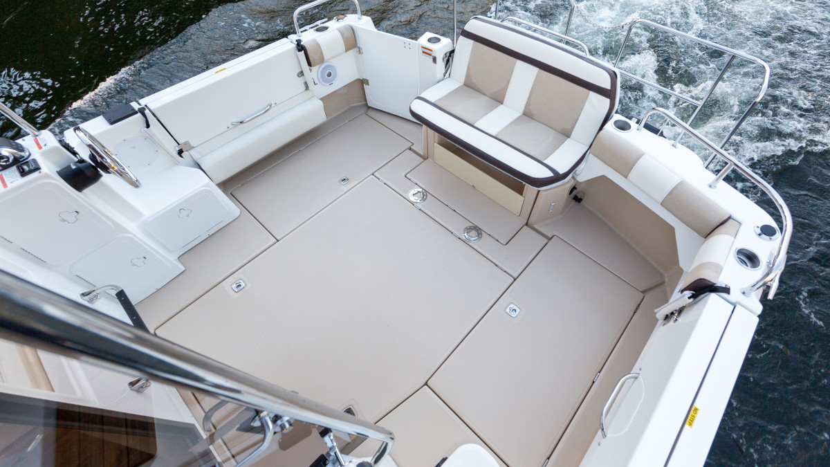 The Cutwater 30's cockpit handles eight with convertible seating, and is plenty big to wrangle a few fish. Good access to the Volvo is underfoot.
