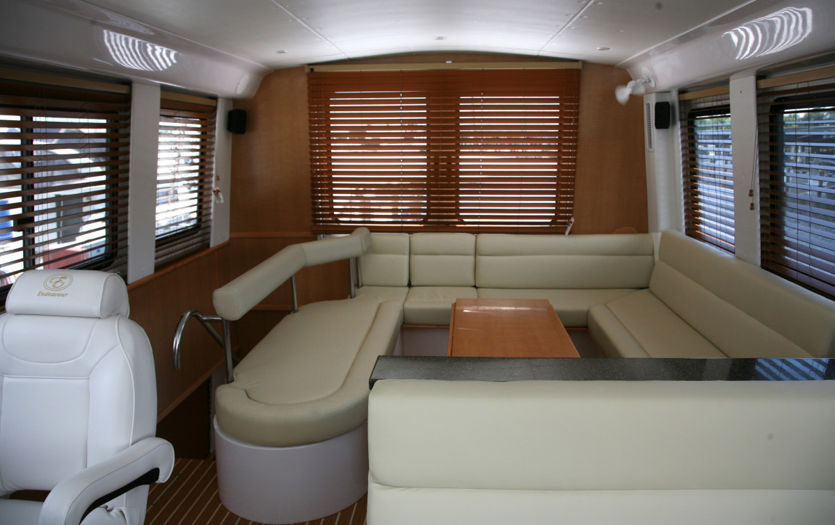 Truly the penthouse of the TrawlerCat 42, the table adjusts to dining or cocktail height.