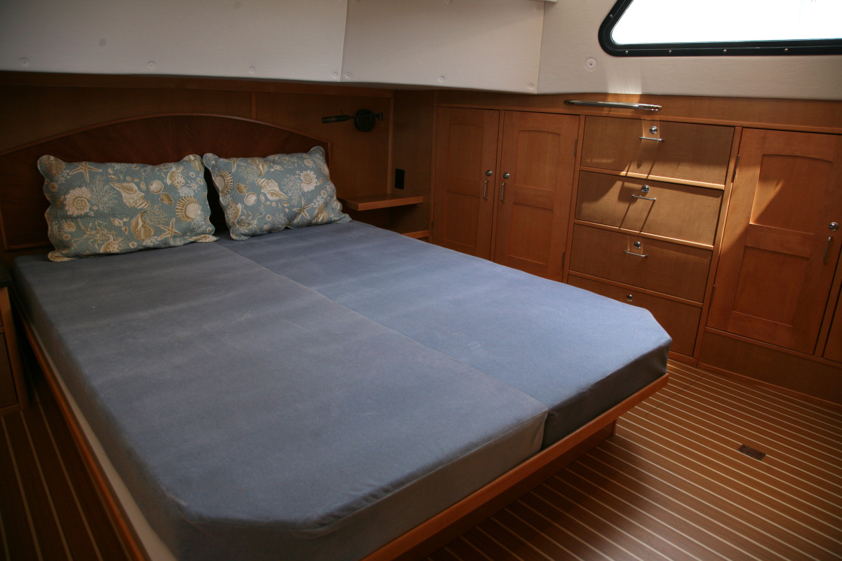 Spanning the superstructure's full beam, the master suite provides all the space a couple would need for extended cruising.