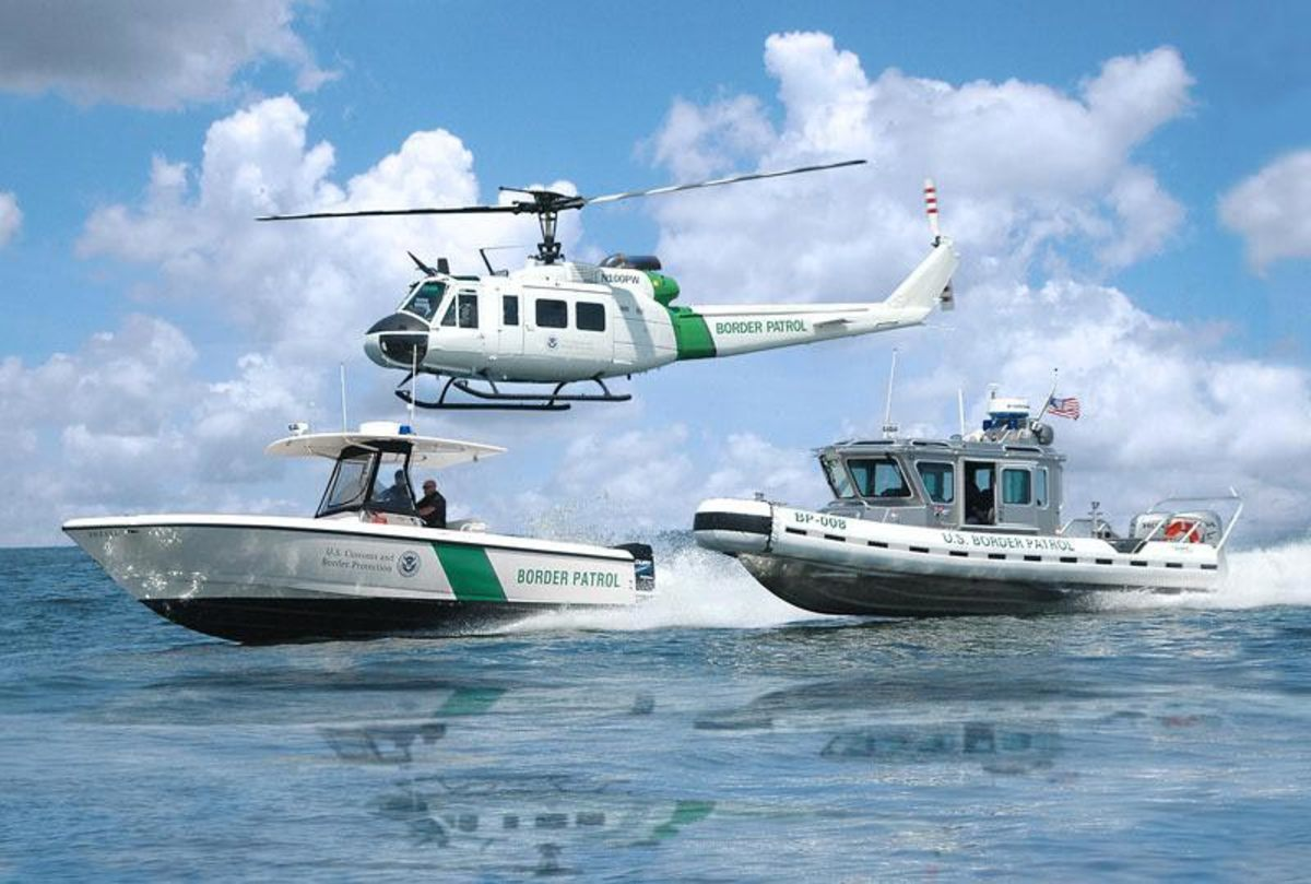 In various colors and sizes, the Racing Stripe became a common emblem for federal, state and local law enforcement and sea service vessels. Such is the case with these Customs and Border Patrol assets. Photo courtesy of U.S. Customs and Border Patrol.