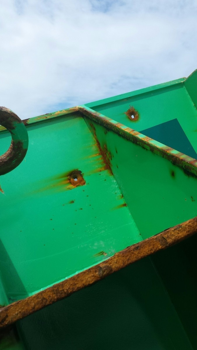 This photo shows a buoy pierced with bullet holes, Monday, April 24, 2017, off the coast of Block Island, Rhode Island. The buoy was found by the crew of Coast Guard Cutter Ida Lewis and the penalty for damaging or tampering with Federal Aids to Navigation is up to 20 years of imprisonment and as much as $2,500 fine per day for each violation. (U.S. Coast Guard photo by Chief Warrant Officer 3 Patrick Morkis)
