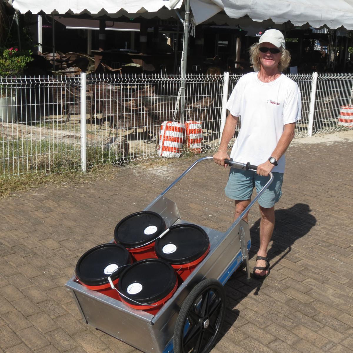 James hauling oil in the Tipke 2100 folding cart.