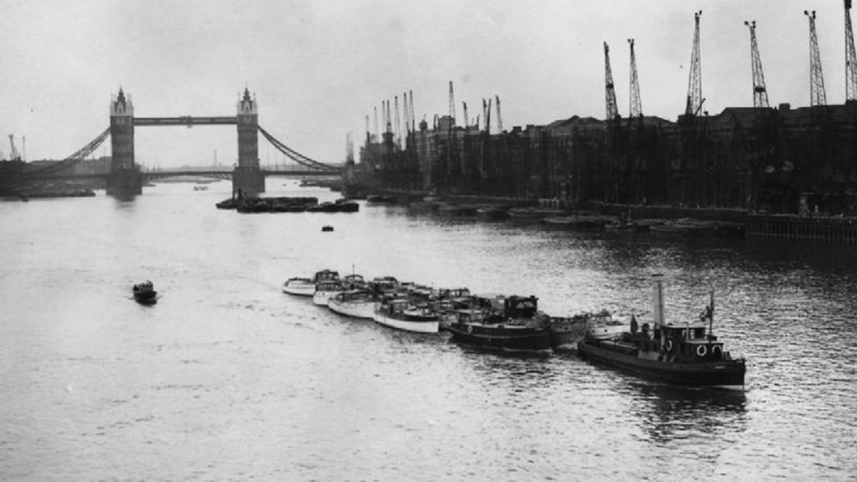 "Some of the ""little ships"" collected by the Britain being towed down the Thames river on their way to Ramsgate, England."