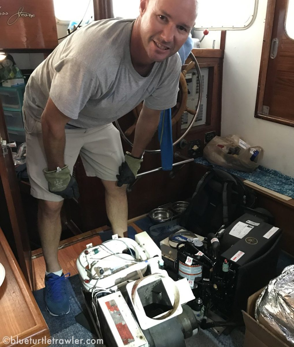 Randy with both AC units – old one on the left (white color) and new one on the right (black).