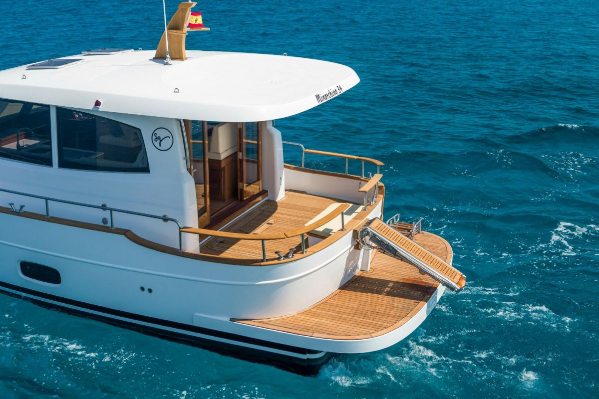 """Showing the 34's generous hardtop overhang, and the optional passarelle for Med-style boarding. Partially visible is the """"hatch-within-a-hatch"""" design to access the engine room space."""