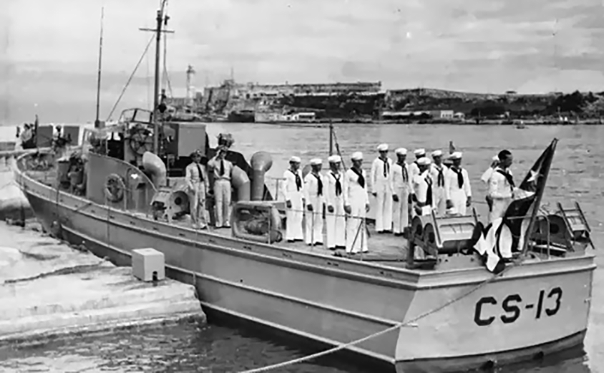 This is CS-13 the smallest patrol craft to have ever sunk a submarine. That is believed to be Norberto Collado next to the Cuban flag.