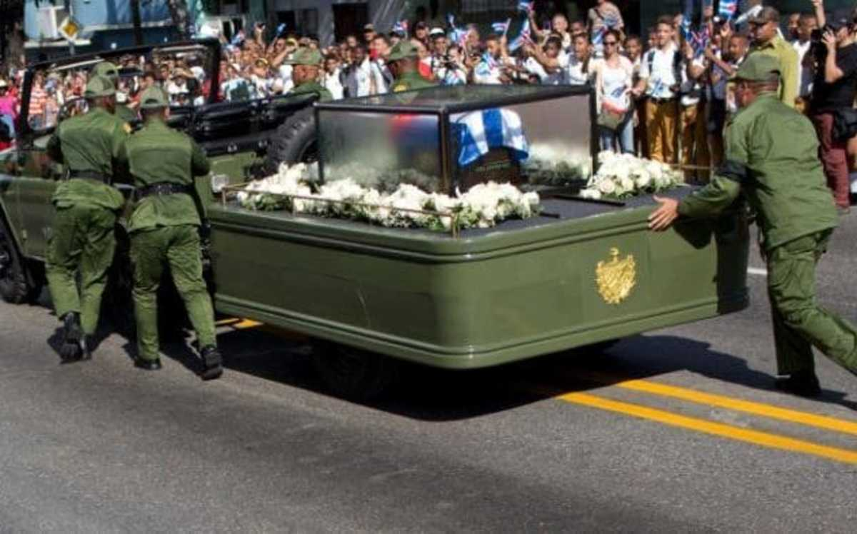 Fidel Castro's ashes are borne by jeep for entombment in Eastern Cuba. In a truly Granma moment, the jeep breaks down and has to be pushed along the route by Cuban soldiers.