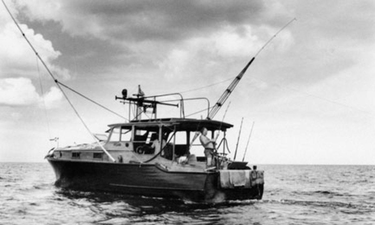 Ernest Hemingway fishes aboard Pilar.