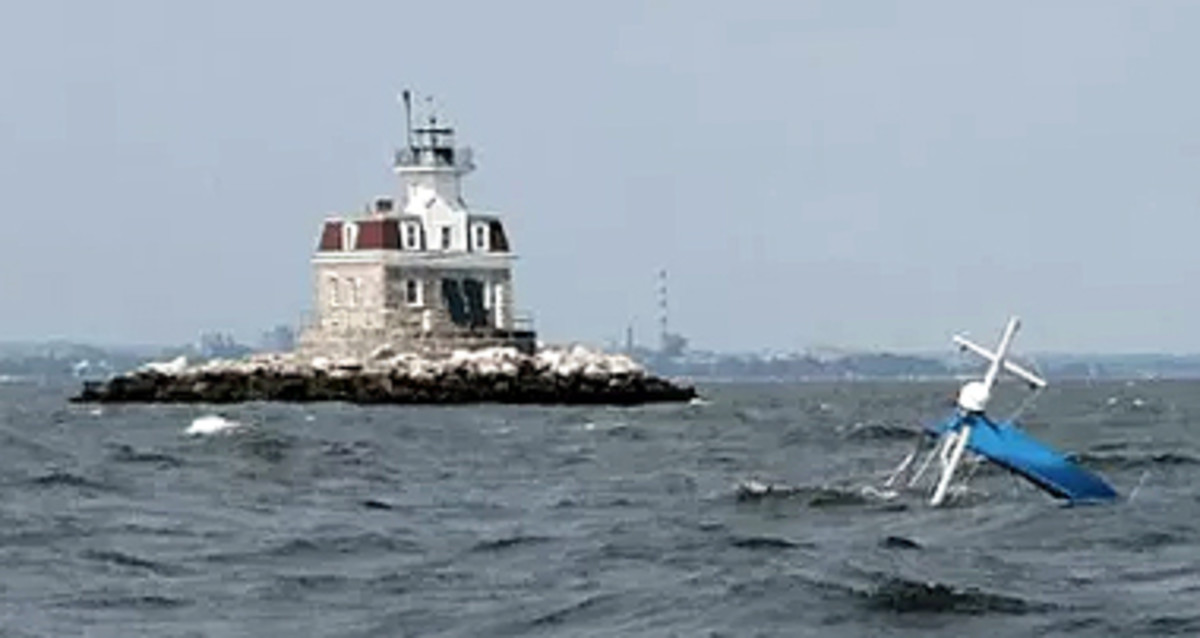 Recovery of the vessel is expected to happen next week. That's Penfield Light in the background.