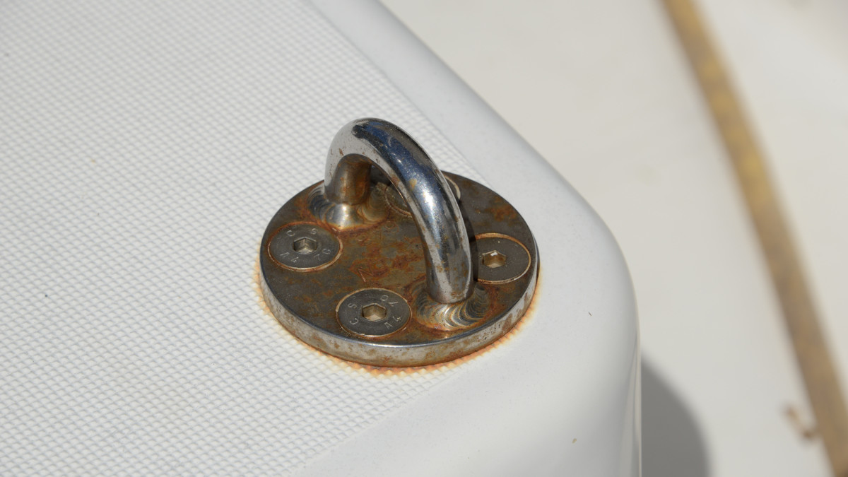 The pad eye in the photo shows signs of rust caused by exposure to salt water.