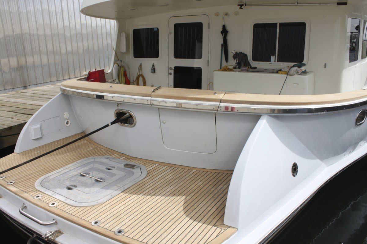 These teak decks added to the aft cockpit and side deck added a yachting touch, but when they were restored to their original brilliance they made the boat really stand out. Despite the maintenance chores of exterior brightwork, a teak deck and cap rail are very special.