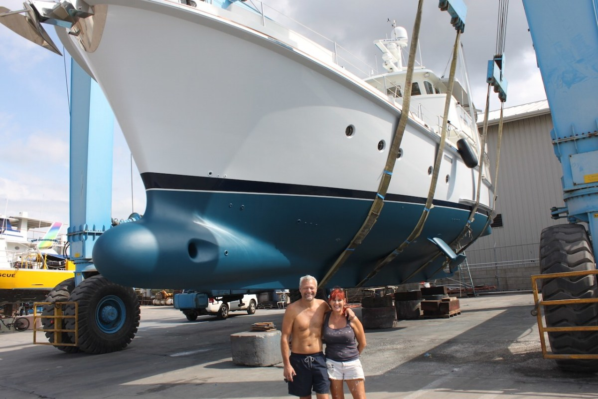 Andy and Julie stand proudly next to the efforts of their labors. Not just tourists in paradise, the couple did most of the work themselves, and are now prepared for more years of cruising the Pacific.
