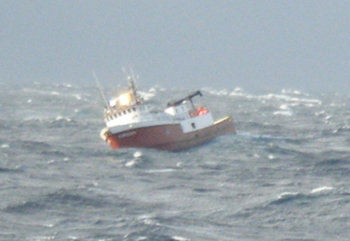This fishing boat, having lost power, has turned beam to the seas and subject to extreme rolling.