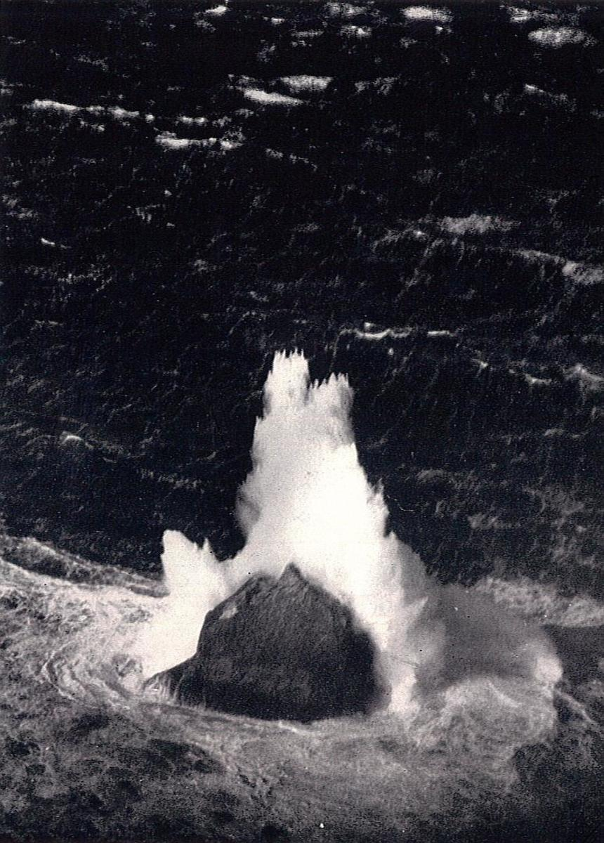 A 1943 photograph of a large wave breaking over the islet of Rockall in the North Atlantic. Rockall's peak is about 56-feet above sea level, and the height of the spray has been estimated to be about 170-feet high.