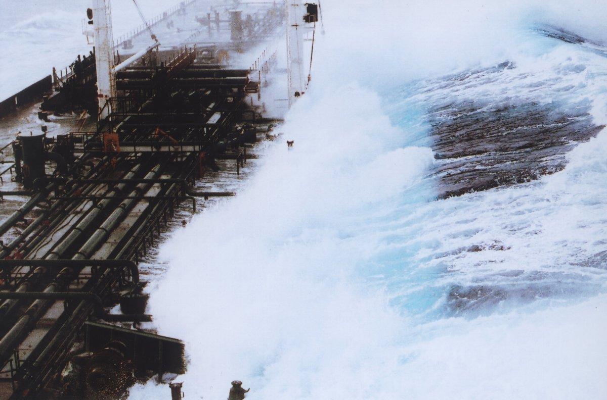 Wave hitting a tanker abeam.