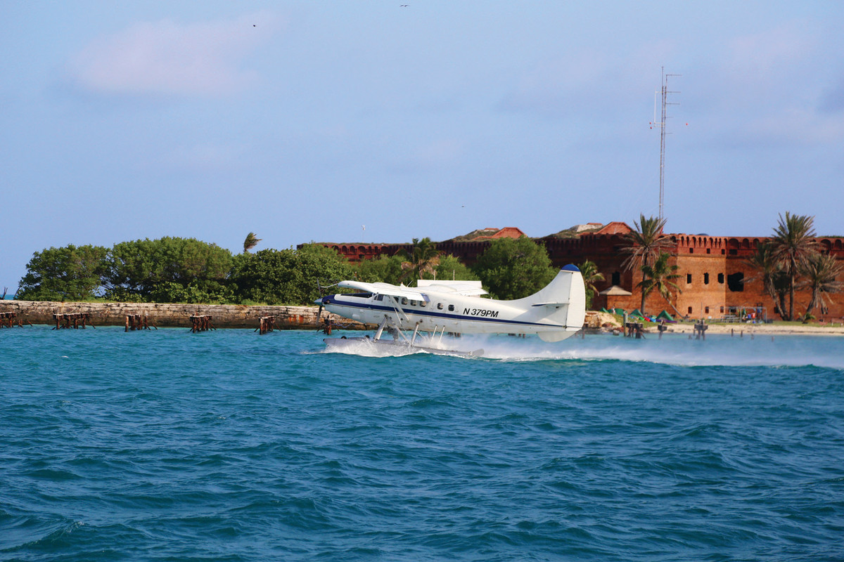 Seaplanes full of tourists take off and land all day long in Garden Key.