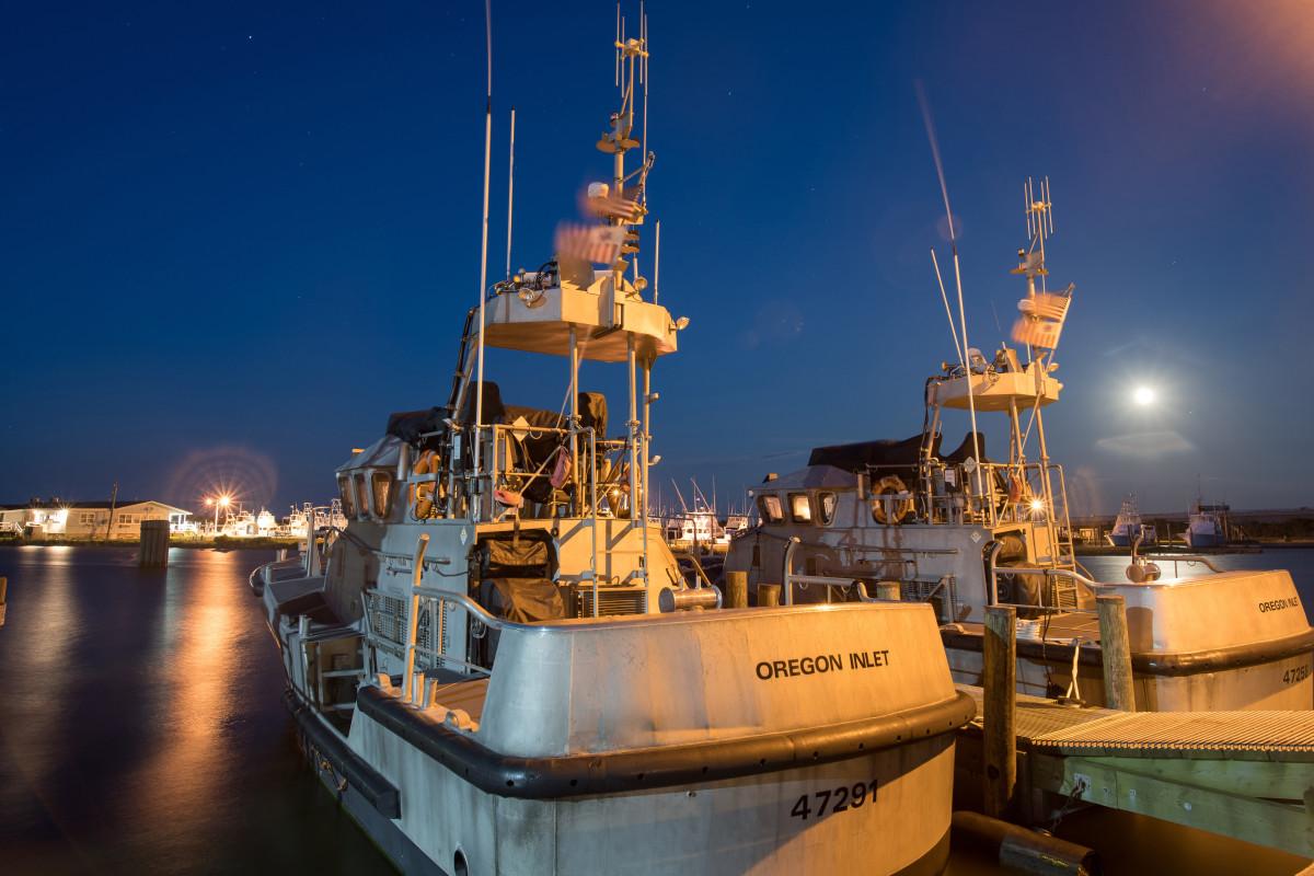 Two Coast Guard 47-foot Motor Life Boats sit at the pier at Coast Guard Station Oregon Inlet in Nags Head, North Carolina
