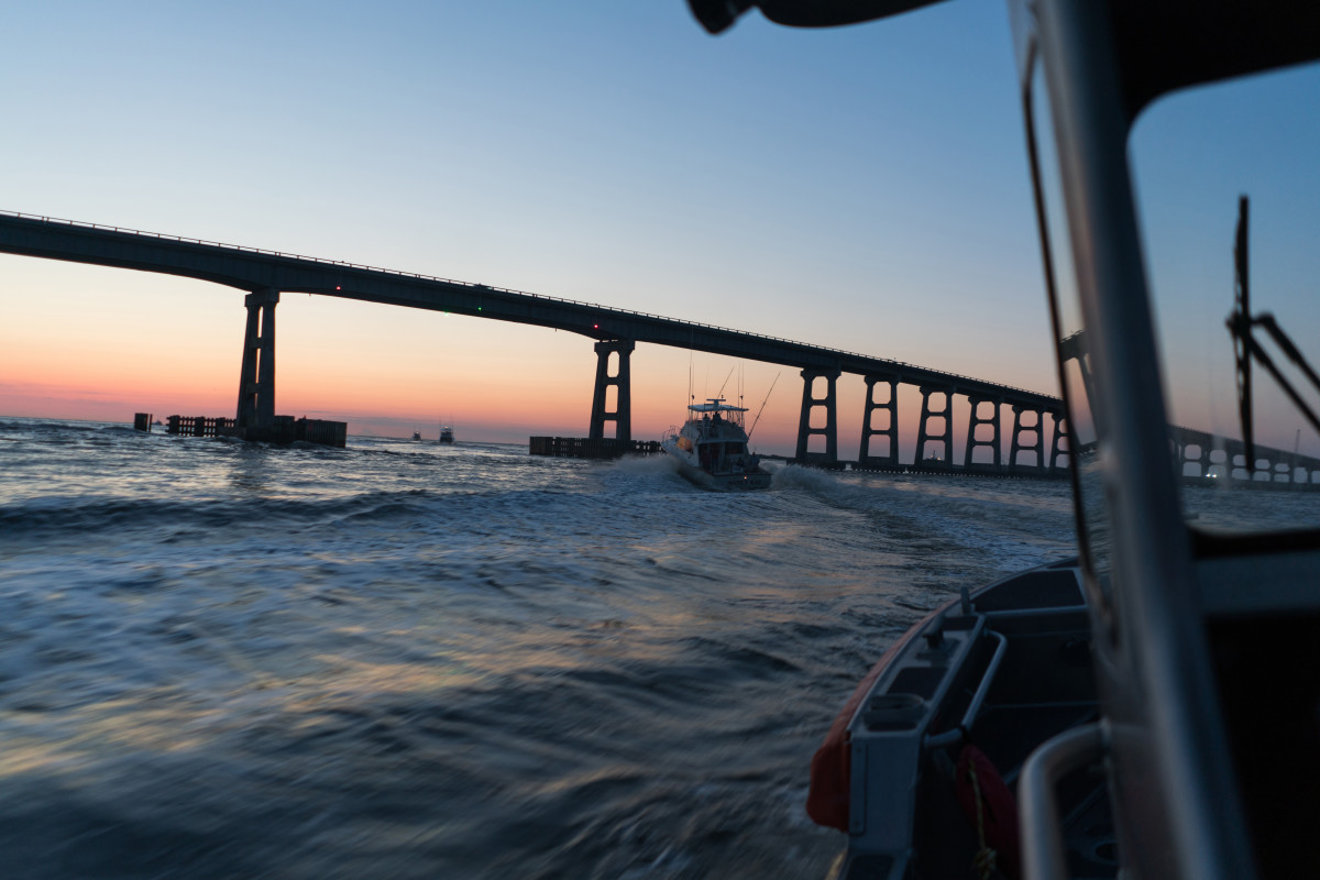 A Coast Guard 24-foot Special Purpose Craft-Shallow Water boat from Coast Guard Station Oregon Inlet in Nags Head, North Carolina, gets underway for an early morning patrol in Oregon Inlet.