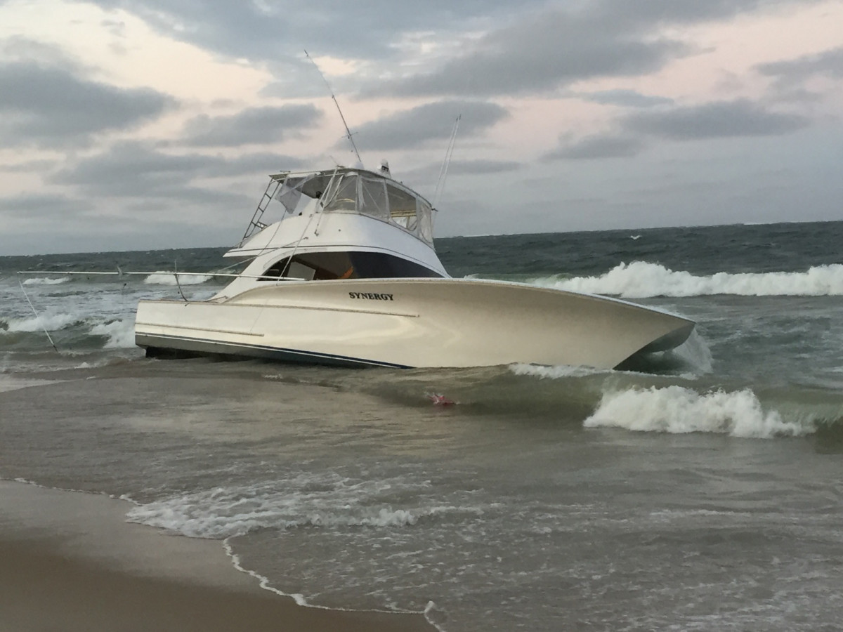 The 54-foot fishing boat Synergy washes up on the beach after capsizing in Oregon Inlet, North Carolina, Sept. 16, 2017. Watchstanders at Coast Guard Sector North Carolina in Wilmington, North Carolina, were alerted at about 5 p.m. that Synergy had capsized and five people were in the water.