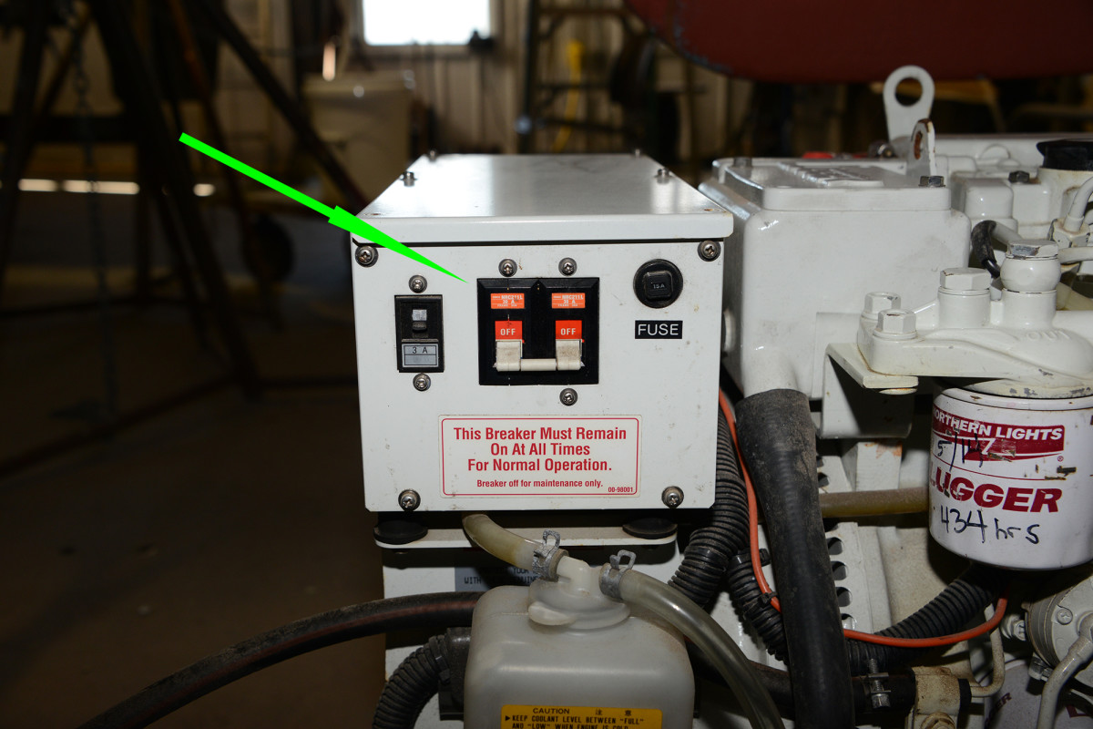 When the genset runs but has no output, look for a breaker like this one mounted on the generator. This breaker protects against an overload from high demands.