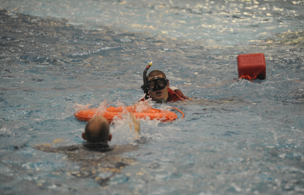 A Rescue Swimmer practicing a save.