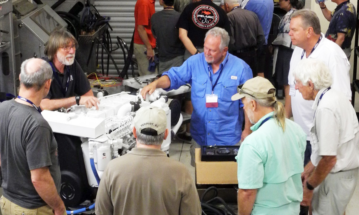 Nigel Calder, at top left, explains the workings of a Cummins engine.