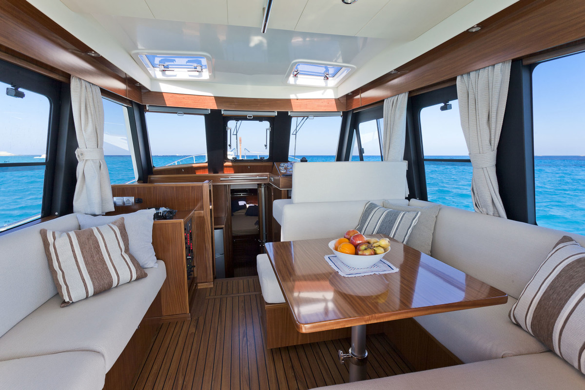 Open sightlines, lots of light, and comfortable seating invite crew and guests to relax.