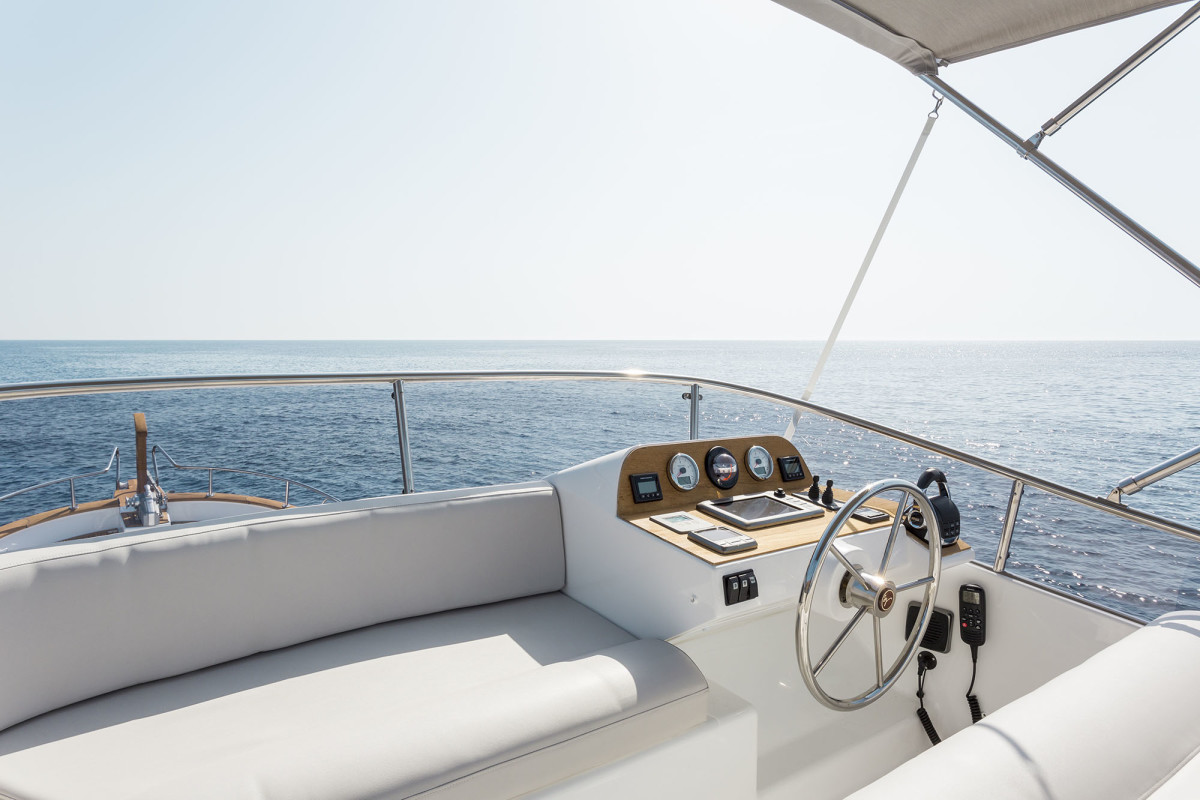 On the flybridge, the helm is straightforward and uncluttered.