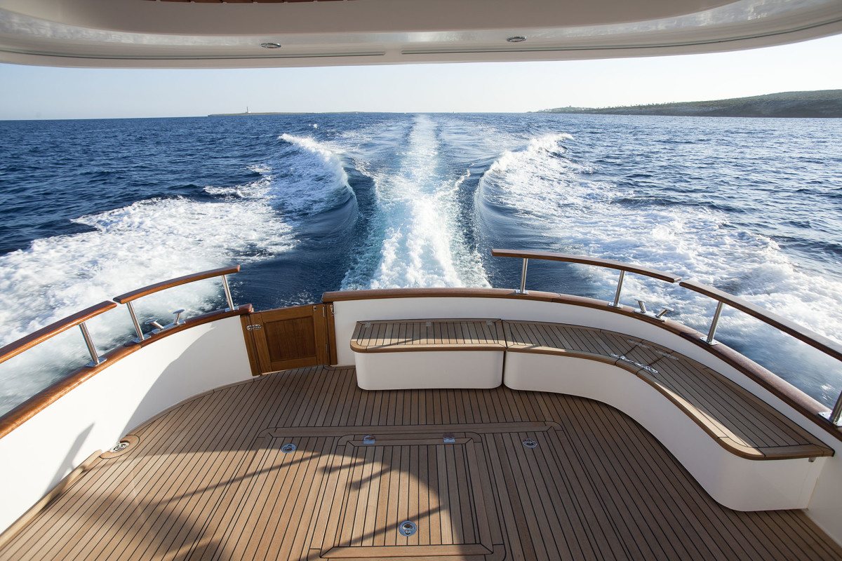 The size of a ballroom dance floor, the afterdeck is the perfect spot to watch this clean wake and enjoy the sun. Also visible in this photo is the clever nested hatch design that permits access to the engine room two ways.
