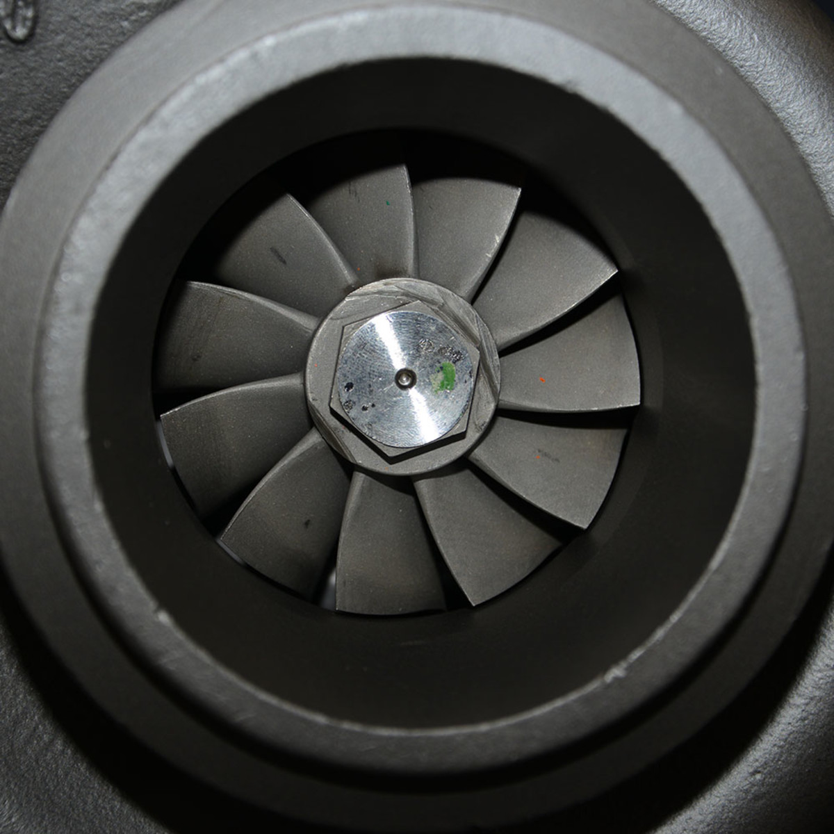 Up close and personal view of a turbocharger's compressor wheel.